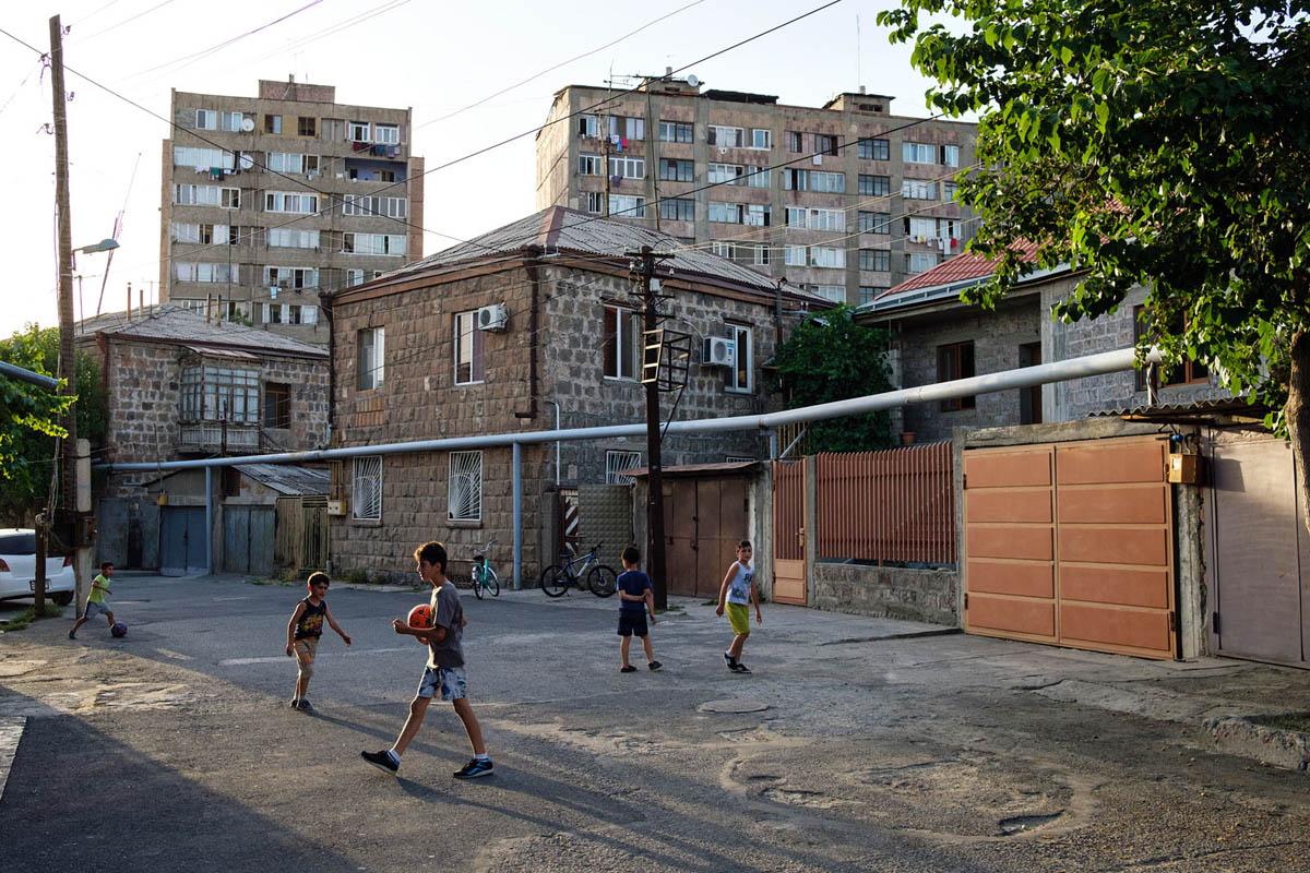 armenia_yerevan_city_street_residential_blocks_children_playing_ball_architecture