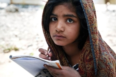 A young girl at provisionary school in one of the camps for the 2005 earthquake survivors in Balakot, Pakistan.