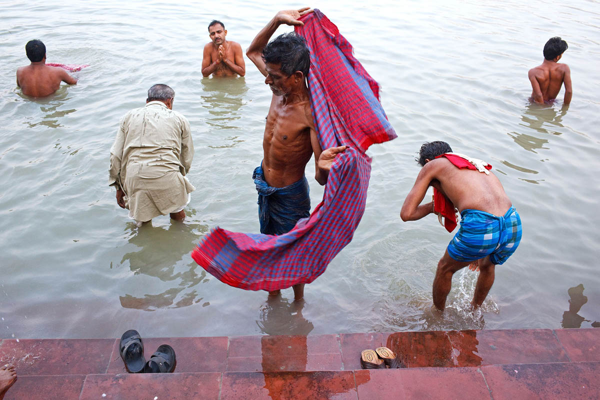 Morning bathing at the Mallick Ghat on Hooghly River in Kolkata, India.