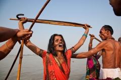 A woman in trance performs religious rituals in Gandak River during Sonepur Mela.